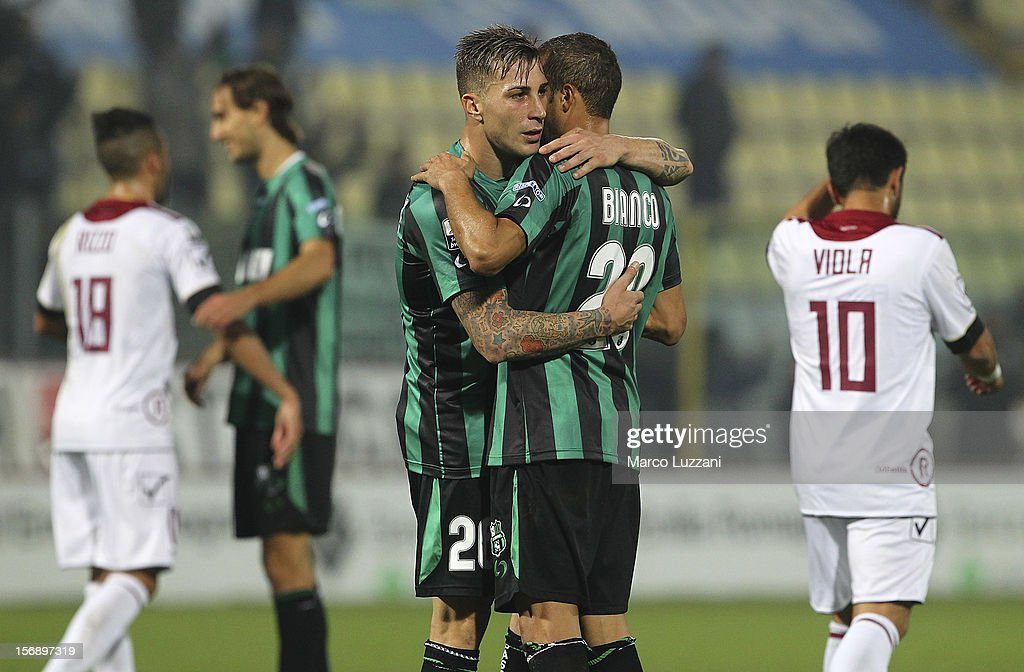 Emanuele Terranova (L) and Paolo Bianco (R) of US Sassuolo celebrate victory at the end of the Serie B match between US Sassuolo and Reggina Calcio at Alberto Braglia Stadium on November 24, 2012 in Modena, Italy.