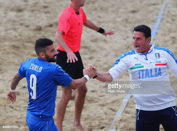 Emanuele Zurlo and his coach of Italy Massimo Agostini celebrate during the Euro Beach Soccer League Superfinal match between Italy and Ukraine on...