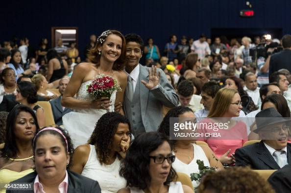Emanuella Rosa and Romilda Celina pose before their wedding ceremony at the Court of Justice of the State of Rio de Janeiro on December 8 2013 130...