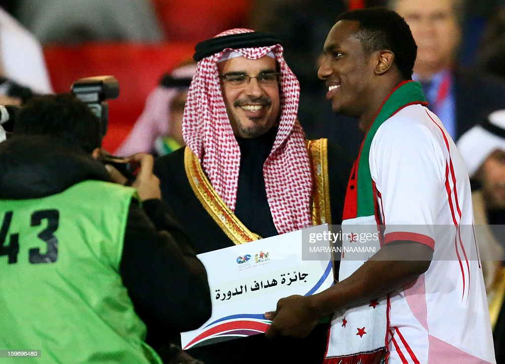 Emarati player Ahmad Khalil (R) receives the best scorer diploma for the 21st Gulf Cup from Bahraini Crown Prince Salman bin Hamad bin Isa Al Khalifa at the end of the Cup's final on January 18, 2013 in Manama. United Arab Emirates won 2-1 against Iraq.