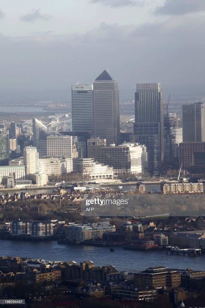 This picture taken on January 9, 2013 shows the view of London's Canary Wharf as seen from the 68th floor of 'The Shard' in central London . The Shard, Europe's tallest skyscraper, opens its viewing platform to the public on February 1, giving an unrivalled view of London and defiantly snubbing critics of the gigantic project. The 310-metre (1,017-foot) Shard has been described as too high, too audacious and too likely to cast its shadow over the historic monuments nearby -- and too costly at a time of austerity, even though 95 percent of its £450 million ($727 million, 548 million euros) cost has been financed by Qatar.