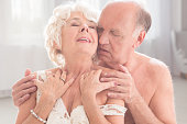 Shot of a naked senior man holding his wife in a passionate embrace
