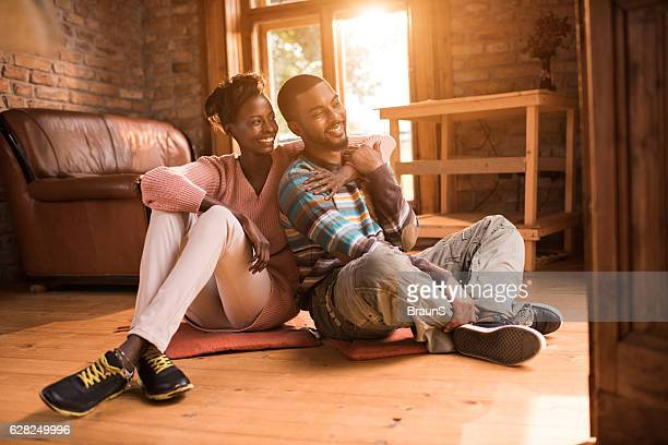 Embraced African American couple spending their time at home.