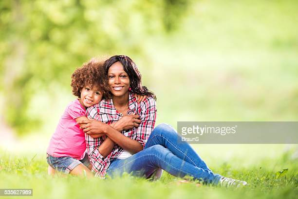 Embraced African American mother and daughter.