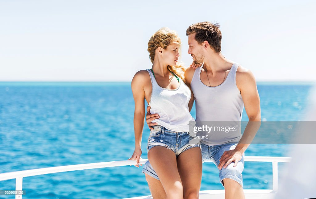 Embraced couple on a boat. : Stock Photo
