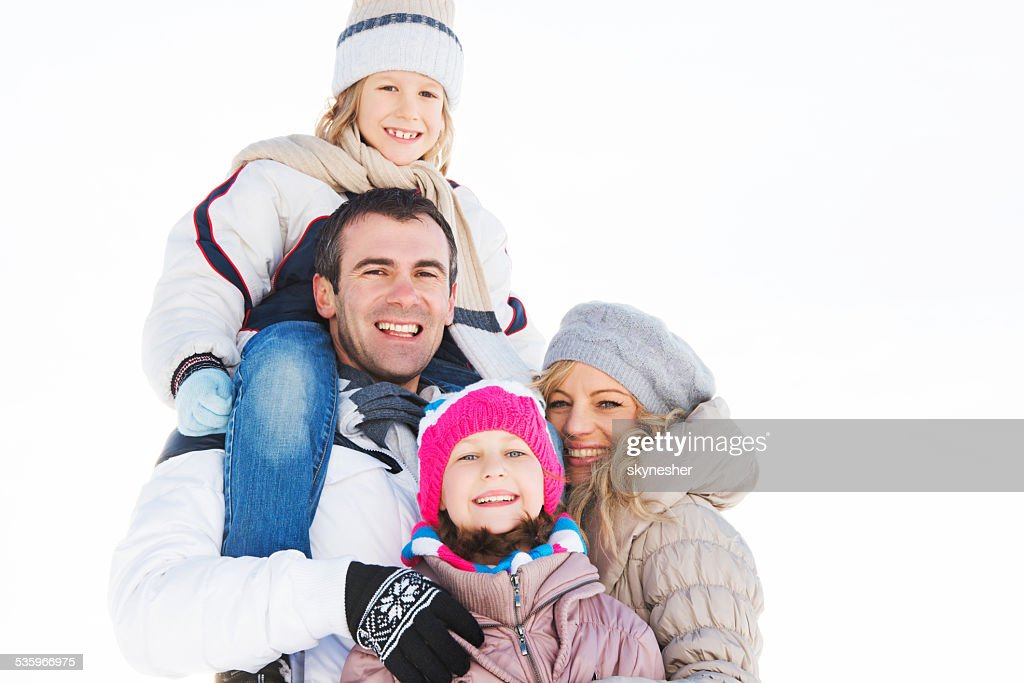 Embraced family during winter season. : Stock Photo