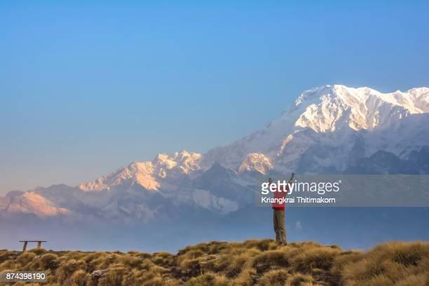 Embracing nature at Annapurna massif during Mardi Himal trekking, Nepal.