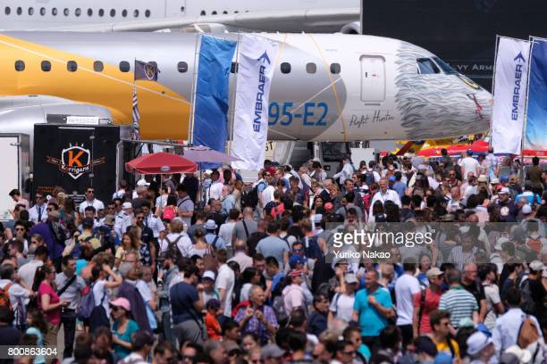 Embraer E195E2 is displayed as people visit the Le Bourget Airport on the first public day of the 52nd International Paris Air Show on June 23 in...