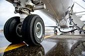 Embraer ERJ 145 aircraft landing gear on the runway