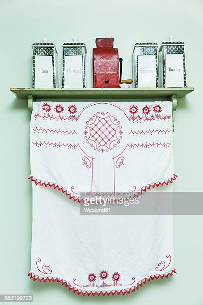 Embroidered cloth and sotrage vessels in kitchen