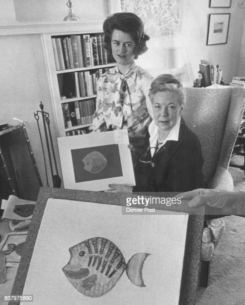 Embroiderers Fish For Designs Mrs Gary Christy left and Mrs William L Gordon look over fish design entered in first critique of Colorado Chapter...