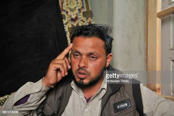 Embroidery artisan Farooq Ahmad Dar who was used as a human shield by army sits in his home in Chill village on May 23 2017 in Budgam India A video...