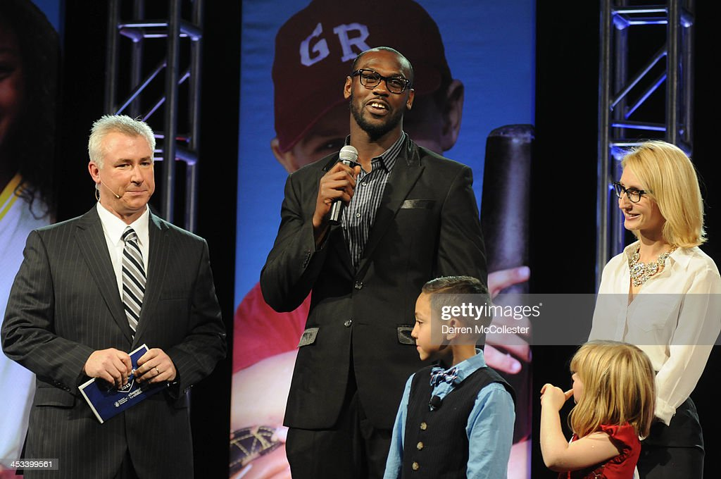 Emcee Dan Roche, New England Patriots' <a gi-track='captionPersonalityLinkClicked' href=/galleries/search?phrase=Chandler+Jones&family=editorial&specificpeople=7181843 ng-click='$event.stopPropagation()'>Chandler Jones</a> and Dr. Christina Vanderpluym attend Champions for Children's at Seaport World Trade Center on December 3, 2013 in Boston, Massachusetts.