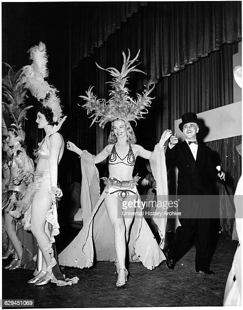 Emcee Leading Chorus Girl Across Stage during Performance to Raise Money for War Bonds During World War II Vallejo California USA 1943