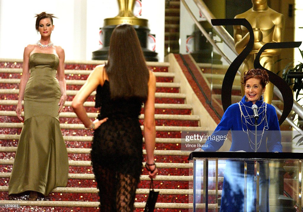 Emcee Patty Fox (R) announces the designs as models go down the runway at the 2003 Oscar Fashion Preview at the Kodak Theatre on March 4, 2003 in Hollywood, California.