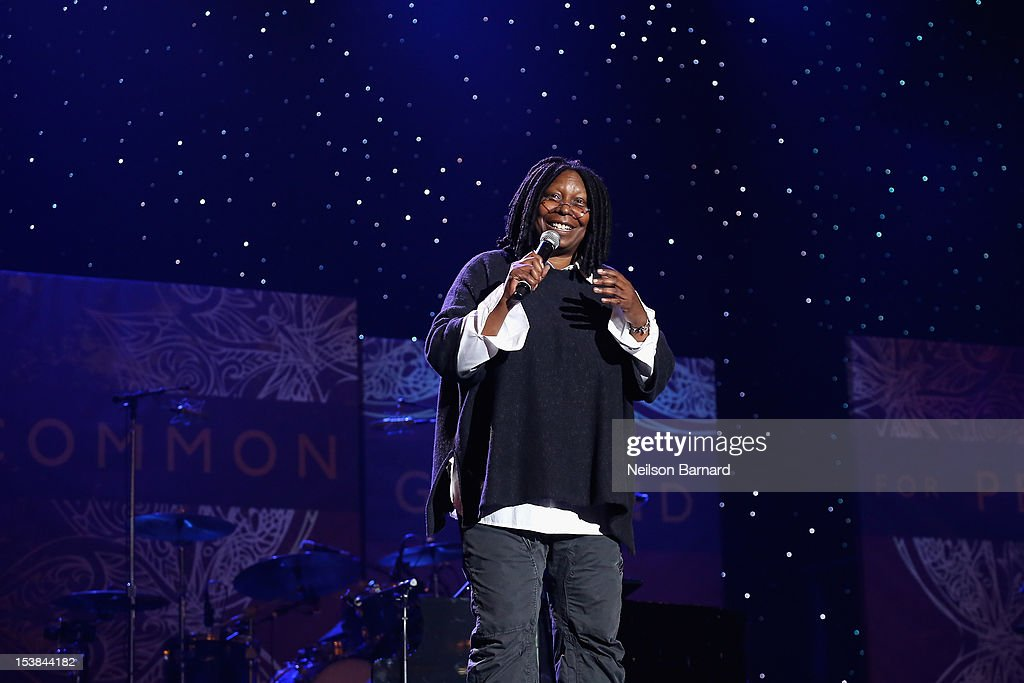 Emcee Whoopi Goldberg speaks onstage at the One World Concert at Syracuse University on October 9 2012 in Syracuse New York