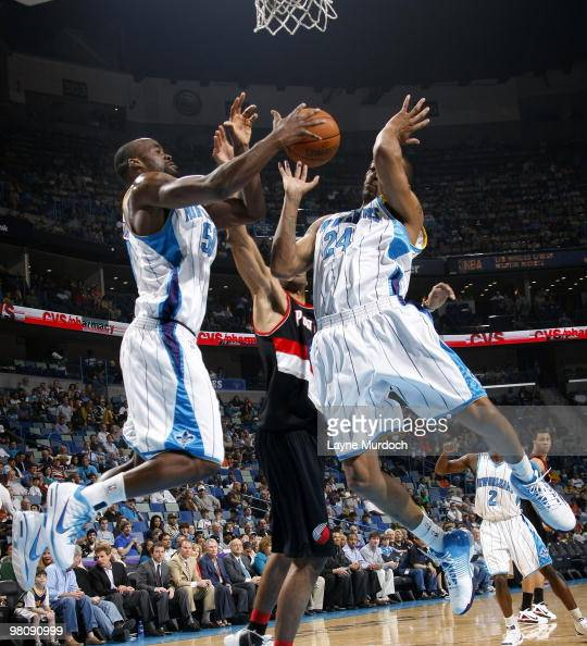 Emeka Okafor and Morris Peterson of the New Orleans Hornets go for a rebound against the Portland Trail Blazers on March 27 2010 at the New Orleans...