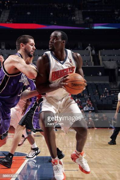 Emeka Okafor of the Charlotte Bobcats moves the ball against Brad Miller of the Sacramento Kings during the game on December 19 2005 at the Charlotte...