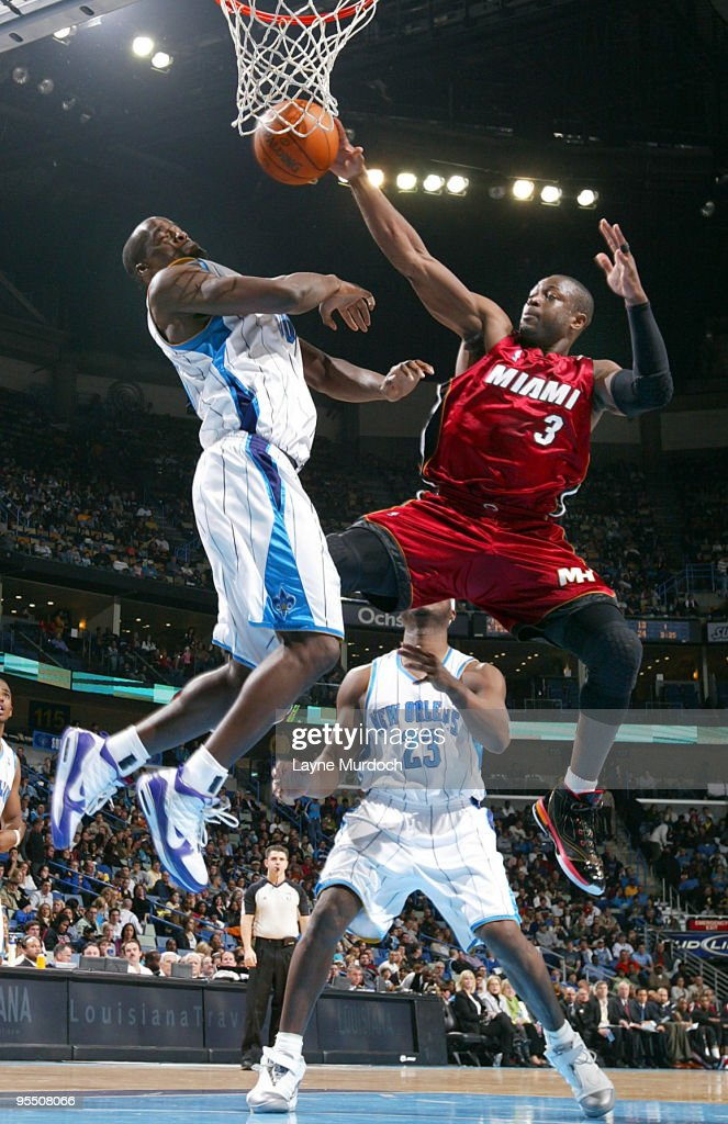 Emeka Okafor of the New Orleans Hornets and Dwyane Wade of the Miami Heat fight for a rebound on December 30 2009 at the New Orleans Arena in New...
