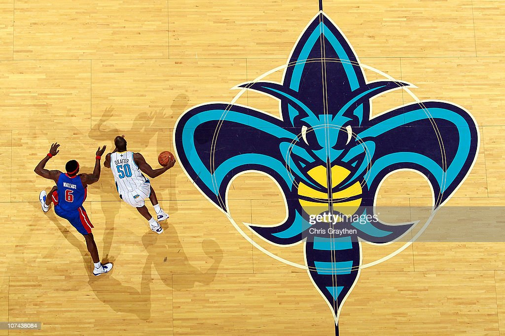 <a gi-track='captionPersonalityLinkClicked' href=/galleries/search?phrase=Emeka+Okafor&family=editorial&specificpeople=201739 ng-click='$event.stopPropagation()'>Emeka Okafor</a> #50 of the New Orleans Hornets drives the ball around <a gi-track='captionPersonalityLinkClicked' href=/galleries/search?phrase=Ben+Wallace&family=editorial&specificpeople=201480 ng-click='$event.stopPropagation()'>Ben Wallace</a> #6 of the Detroit Pistons at the New Orleans Arena on December 8, 2010 in New Orleans, Louisiana. The Hornets defeated the Pistons 93-74.