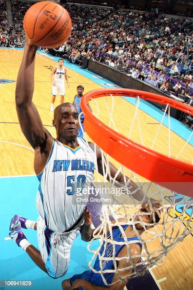 Emeka Okafor of the New Orleans Hornets dunks the ball against the Dallas Mavericks at the New Orleans Arena on November 17 2010 in New Orleans...