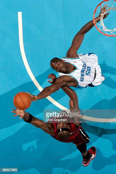 Emeka Okafor of the New Orleans Hornets fights for a rebound with Jermaine O'Neal of the Miami Heat at New Orleans Arena on December 30 2009 in New...