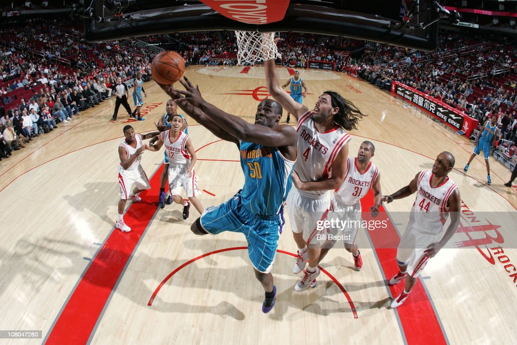 Emeka Okafor of the New Orleans Hornets shoots the ball over Luis Scola the Houston Rockets on January 14 2011 at the Toyota Center in Houston Texas...