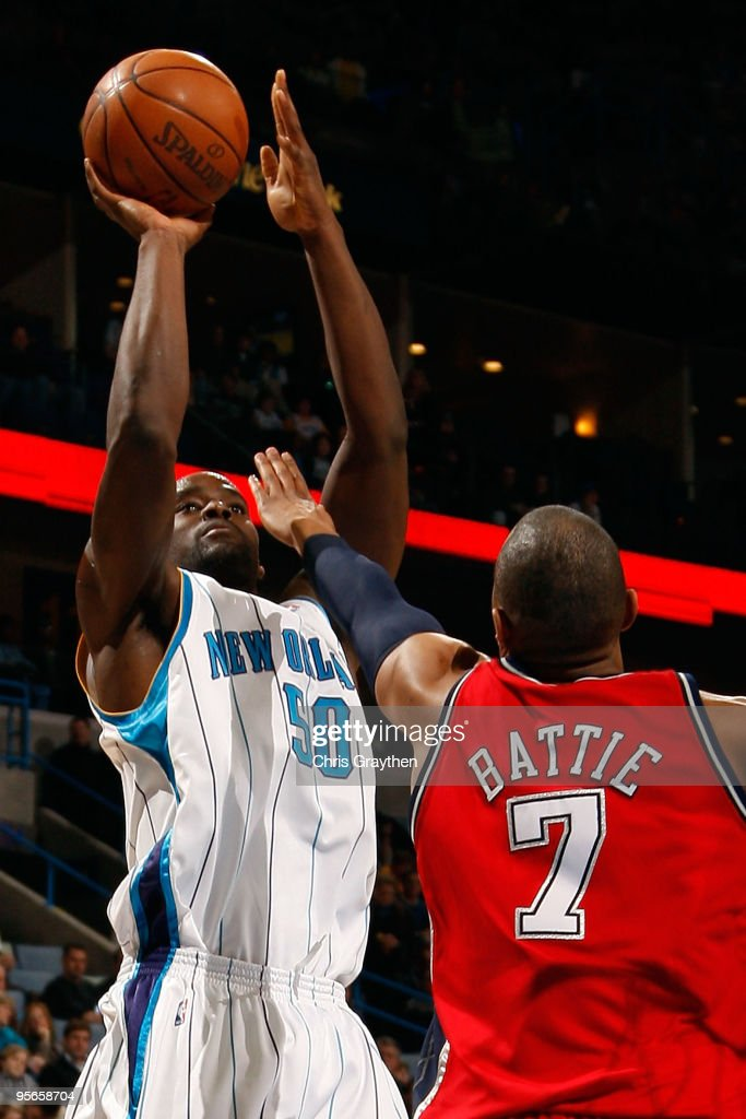 Emeka Okafor of the New Orleans Hornets shoots the ball over Tony Battie of the New Jersey Nets at the New Orleans Arena on January 8 2010 in New...