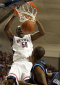 Emeka Okafor of the UCONN Huskies dunks the ball over the Georgetown Hoyas on January 14 2004 at the Gampel Pavilion in Storrs Connecticut
