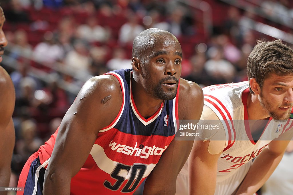 Emeka Okafor #50 of the Washington Wizards and Chandler Parsons #25 of the Houston Rockets look on during the game on December 12, 2012 at the Toyota Center in Houston, Texas.