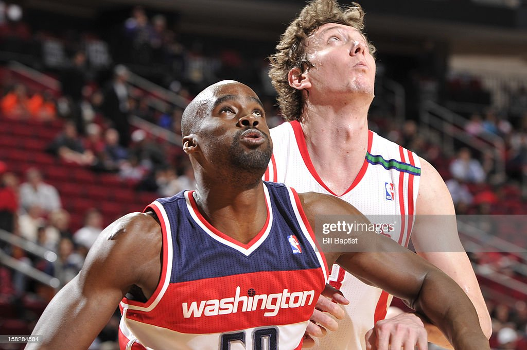 Emeka Okafor #50 of the Washington Wizards and Omer Asik #3 of the Houston Rockets battle for a rebound on December 12, 2012 at the Toyota Center in Houston, Texas.