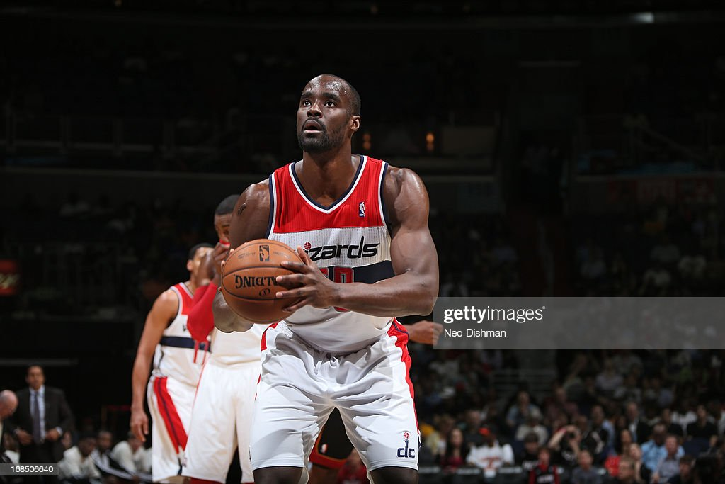 <a gi-track='captionPersonalityLinkClicked' href=/galleries/search?phrase=Emeka+Okafor&family=editorial&specificpeople=201739 ng-click='$event.stopPropagation()'>Emeka Okafor</a> #50 of the Washington Wizards attempts a foul shot against the Miami Heat at the Verizon Center on April 10, 2013 in Washington, DC.