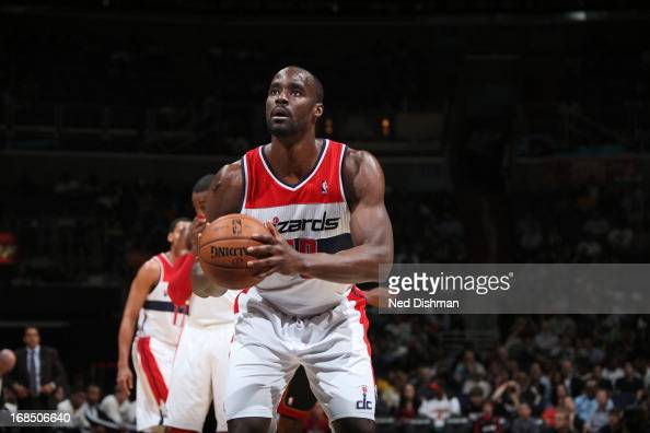 Emeka Okafor of the Washington Wizards attempts a foul shot against the Miami Heat at the Verizon Center on April 10 2013 in Washington DC NOTE TO...