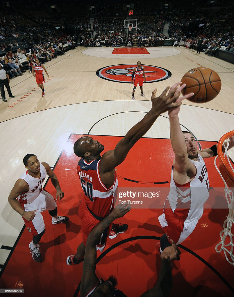Emeka Okafor #50 of the Washington Wizards blocks a shot against Jonas Valanciunas #17 of the Toronto Raptors during the game on April 3, 2013 at the Air Canada Centre in Toronto, Ontario, Canada.