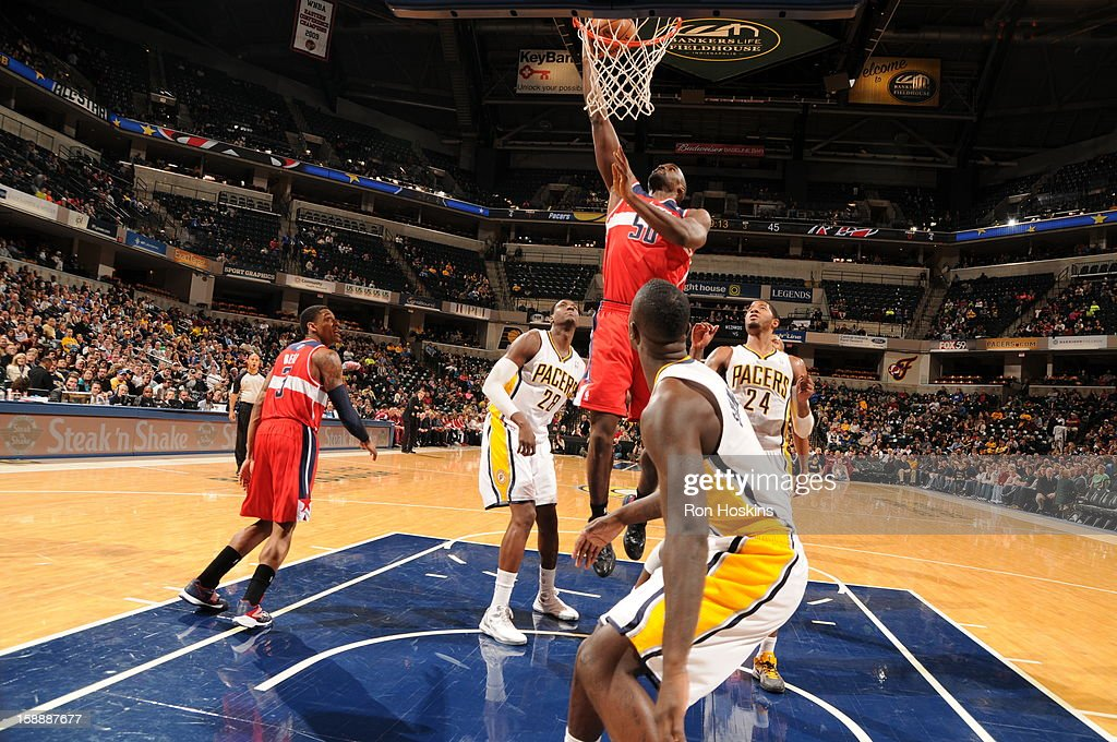 <a gi-track='captionPersonalityLinkClicked' href=/galleries/search?phrase=Emeka+Okafor&family=editorial&specificpeople=201739 ng-click='$event.stopPropagation()'>Emeka Okafor</a> #50 of the Washington Wizards dunks against <a gi-track='captionPersonalityLinkClicked' href=/galleries/search?phrase=Ian+Mahinmi&family=editorial&specificpeople=740196 ng-click='$event.stopPropagation()'>Ian Mahinmi</a> #28 and Paul George #24 of the Indiana Pacers on January 2, 2013 at Bankers Life Fieldhouse in Indianapolis, Indiana.