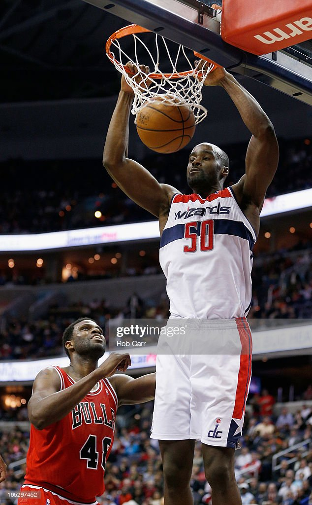Emeka Okafor #50 of the Washington Wizards dunks in front of Nazr Mohammed #48 of the Chicago Bulls during the second half of the during the Wizards 90-86 win at Verizon Center on April 2, 2013 in Washington, DC.