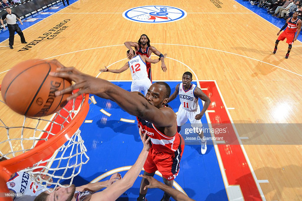 <a gi-track='captionPersonalityLinkClicked' href=/galleries/search?phrase=Emeka+Okafor&family=editorial&specificpeople=201739 ng-click='$event.stopPropagation()'>Emeka Okafor</a> #50 of the Washington Wizards dunks the ball against the Philadelphia 76ers at the Wells Fargo Center on January 30, 2013 in Philadelphia, Pennsylvania.