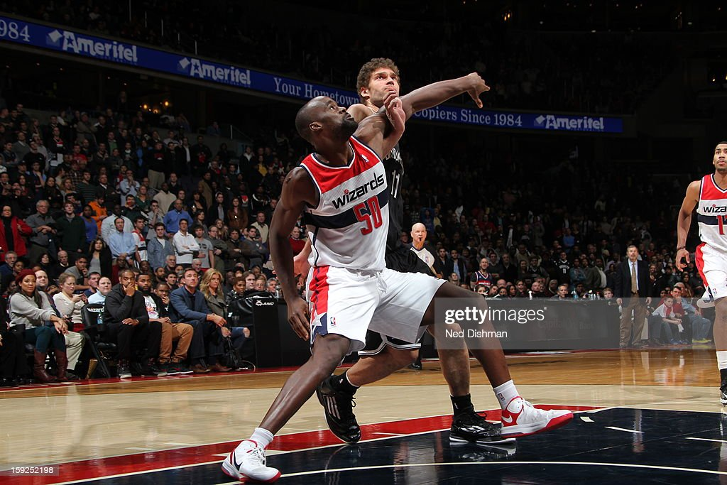 Emeka Okafor #50 of the Washington Wizards fights for position against Brook Lopez #11 of the Brooklyn Nets on January 4, 2013 at the Verizon Center in Washington, DC.