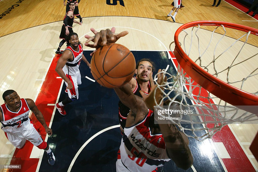 <a gi-track='captionPersonalityLinkClicked' href=/galleries/search?phrase=Emeka+Okafor&family=editorial&specificpeople=201739 ng-click='$event.stopPropagation()'>Emeka Okafor</a> #50 of the Washington Wizards goes up for a rebound against <a gi-track='captionPersonalityLinkClicked' href=/galleries/search?phrase=Joakim+Noah&family=editorial&specificpeople=699038 ng-click='$event.stopPropagation()'>Joakim Noah</a> #13 of the Chicago Bulls at the Verizon Center on January 26, 2013 in Washington, DC.
