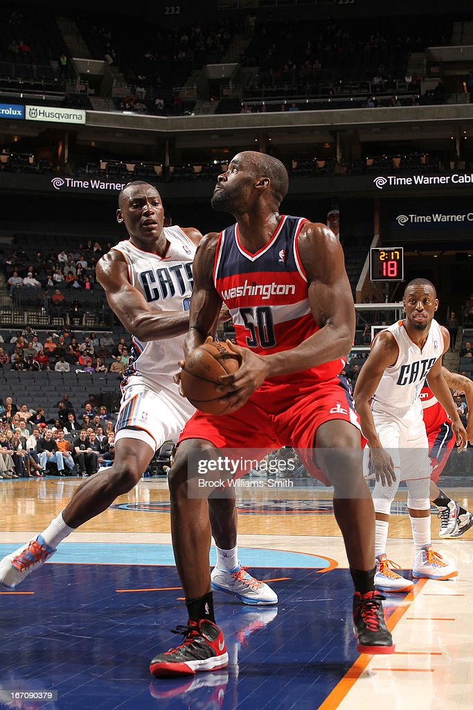 <a gi-track='captionPersonalityLinkClicked' href=/galleries/search?phrase=Emeka+Okafor&family=editorial&specificpeople=201739 ng-click='$event.stopPropagation()'>Emeka Okafor</a> #50 of the Washington Wizards goes up for the layup against the Charlotte Bobcats at the Time Warner Cable Arena on March 18, 2013 in Charlotte, North Carolina.