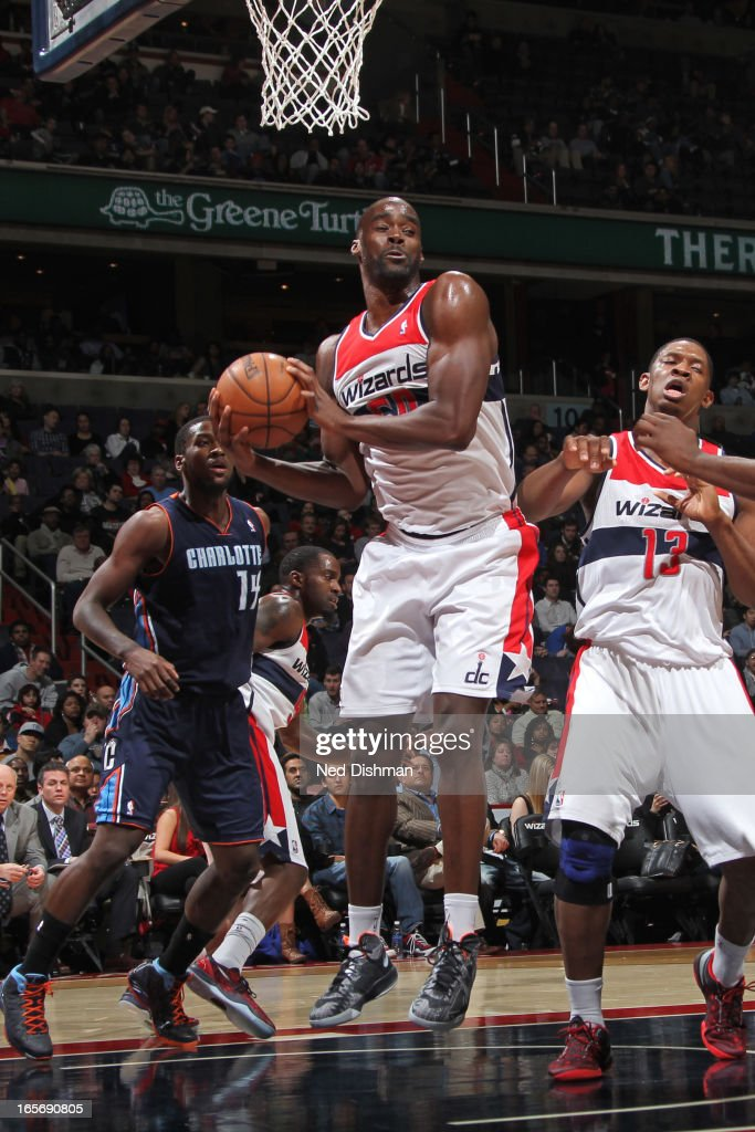 Emeka Okafor #50 of the Washington Wizards grabs a rebound against the Charlotte Bobcats at the Verizon Center on March 9, 2013 in Washington, DC.