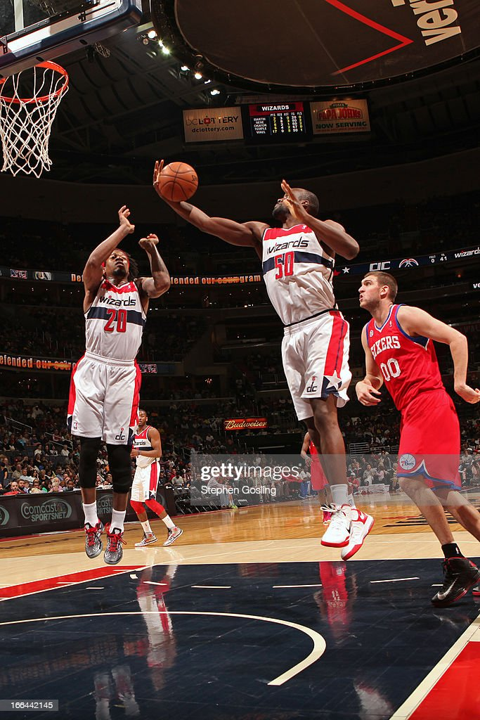 Emeka Okafor of the Washington Wizards grabs a rebound against the Philadelphia 76ers at the Verizon Center on April 12 2013 in Washington DC NOTE TO...
