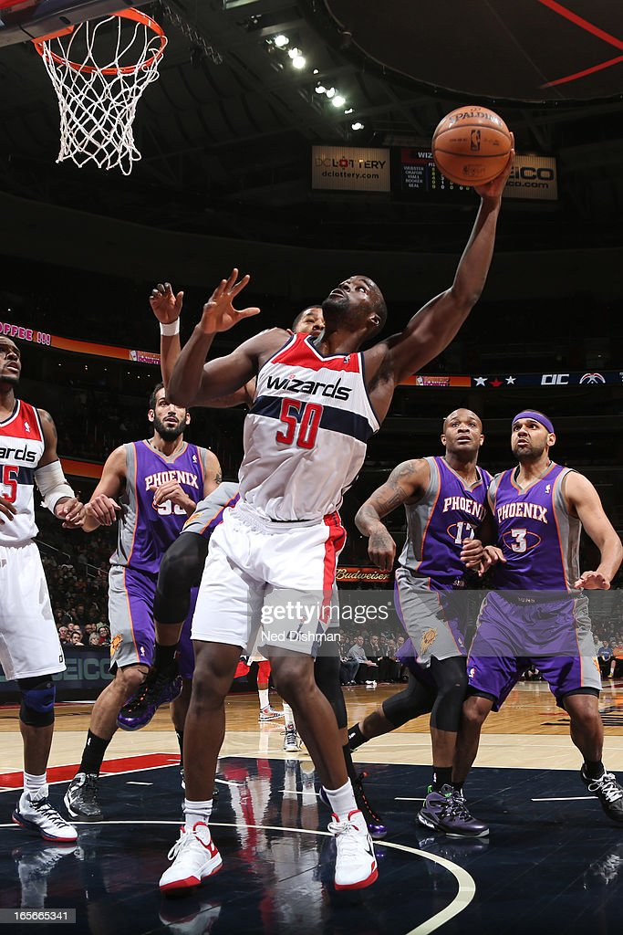 <a gi-track='captionPersonalityLinkClicked' href=/galleries/search?phrase=Emeka+Okafor&family=editorial&specificpeople=201739 ng-click='$event.stopPropagation()'>Emeka Okafor</a> #50 of the Washington Wizards puts up a shot against the Phoenix Suns at the Verizon Center on March 16, 2013 in Washington, DC.