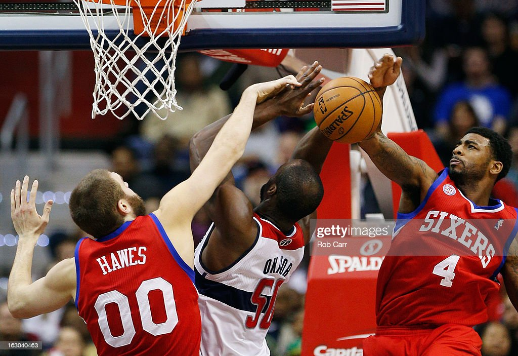 <a gi-track='captionPersonalityLinkClicked' href=/galleries/search?phrase=Emeka+Okafor&family=editorial&specificpeople=201739 ng-click='$event.stopPropagation()'>Emeka Okafor</a> #50 of the Washington Wizards puts up a shot between <a gi-track='captionPersonalityLinkClicked' href=/galleries/search?phrase=Spencer+Hawes&family=editorial&specificpeople=3848319 ng-click='$event.stopPropagation()'>Spencer Hawes</a> #00 and <a gi-track='captionPersonalityLinkClicked' href=/galleries/search?phrase=Dorell+Wright&family=editorial&specificpeople=211344 ng-click='$event.stopPropagation()'>Dorell Wright</a> #4 of the Philadelphia 76ers during the second half at Verizon Center on March 3, 2013 in Washington, DC.