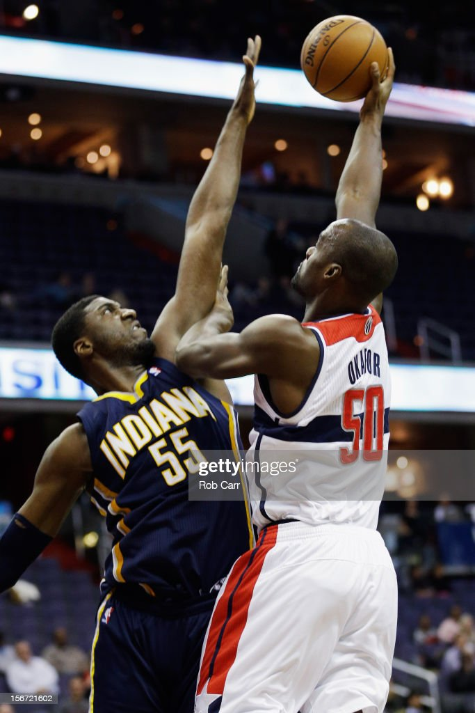 Emeka Okafor #50 of the Washington Wizards puts up a shot over Roy Hibbert #55 of the Indiana Pacers during the first half at Verizon Center on November 19, 2012 in Washington, DC.