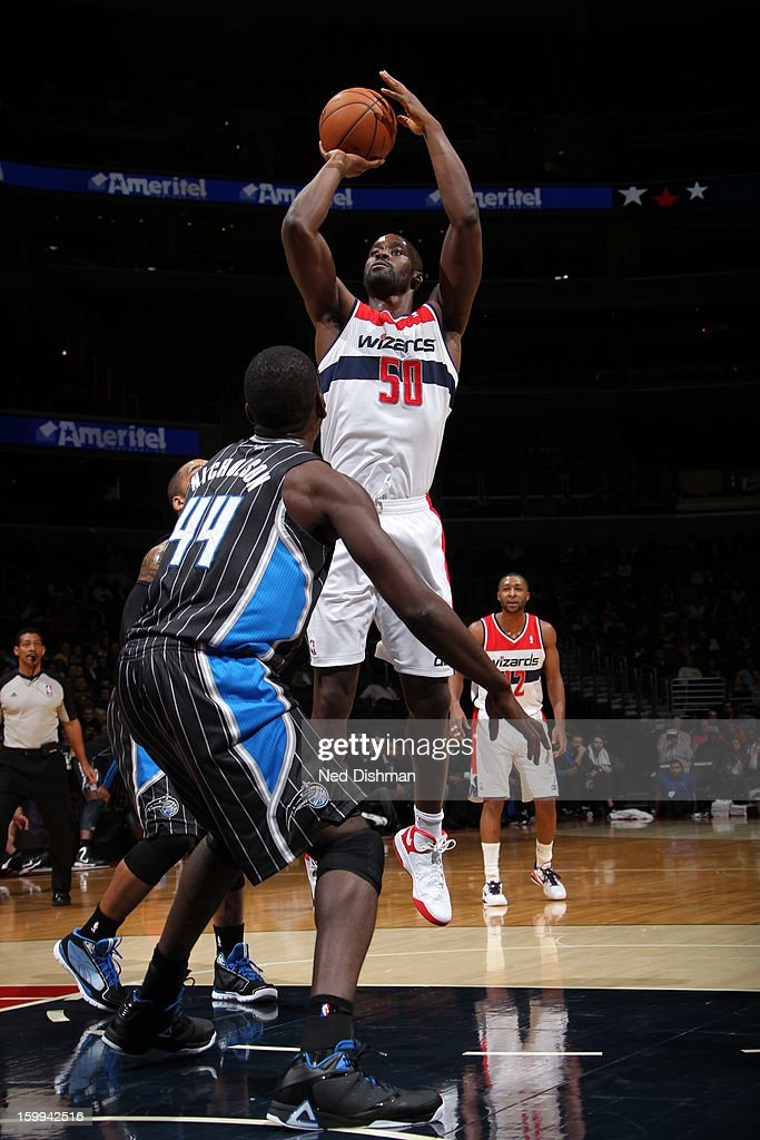 Emeka Okafor #50 of the Washington Wizards shoots a jumper against Andrew Nicholson #44 of the Orlando Magic during the game at the Verizon Center on January 14, 2013 in Washington, DC.