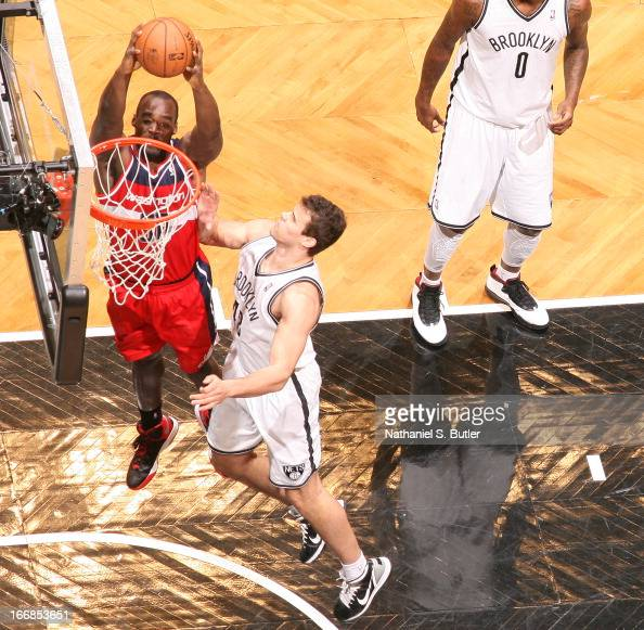 Emeka Okafor of the Washington Wizards shoots against Kris Humphries of the Brooklyn Nets on April 15 2013 at the Barclays Center in the Brooklyn...