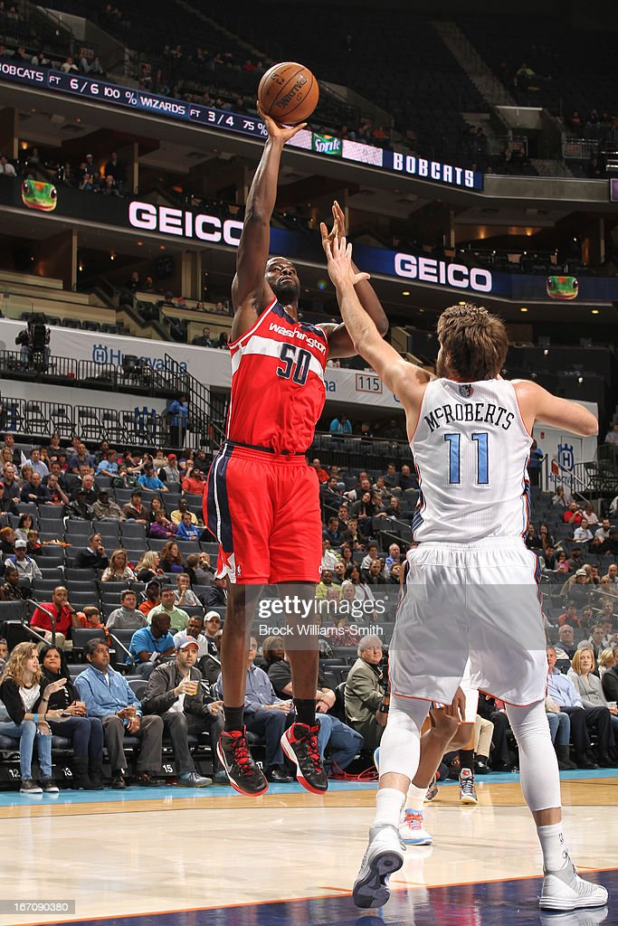 <a gi-track='captionPersonalityLinkClicked' href=/galleries/search?phrase=Emeka+Okafor&family=editorial&specificpeople=201739 ng-click='$event.stopPropagation()'>Emeka Okafor</a> #50 of the Washington Wizards shoots the ball against <a gi-track='captionPersonalityLinkClicked' href=/galleries/search?phrase=Josh+McRoberts+-+Basketball+Player&family=editorial&specificpeople=732530 ng-click='$event.stopPropagation()'>Josh McRoberts</a> #11 of the Charlotte Bobcats at the Time Warner Cable Arena on March 18, 2013 in Charlotte, North Carolina.