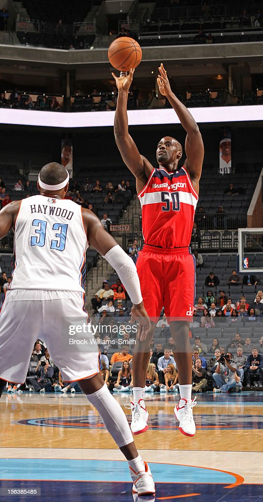 <a gi-track='captionPersonalityLinkClicked' href=/galleries/search?phrase=Emeka+Okafor&family=editorial&specificpeople=201739 ng-click='$event.stopPropagation()'>Emeka Okafor</a> #50 of the Washington Wizards takes a shot against <a gi-track='captionPersonalityLinkClicked' href=/galleries/search?phrase=Brendan+Haywood&family=editorial&specificpeople=202010 ng-click='$event.stopPropagation()'>Brendan Haywood</a> #33 of the Charlotte Bobcats at the Time Warner Cable Arena on November 13, 2012 in Charlotte, North Carolina.