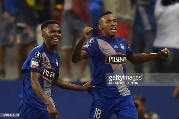 Emelec's Carlos Orejuela celebrates his goal with Eduar Preciado against Melgar from Peru during their 2017 Copa Libertadores football match at...